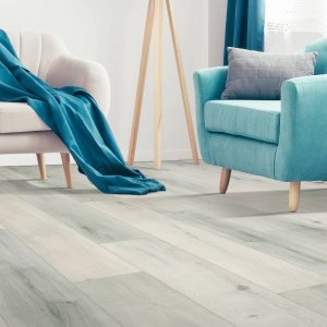 Blue Chair with Laminate Flooring | Dalton Flooring Outlet